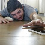Climbing up the downward spiral: Cell phone 'addiction' and the work, play relationship